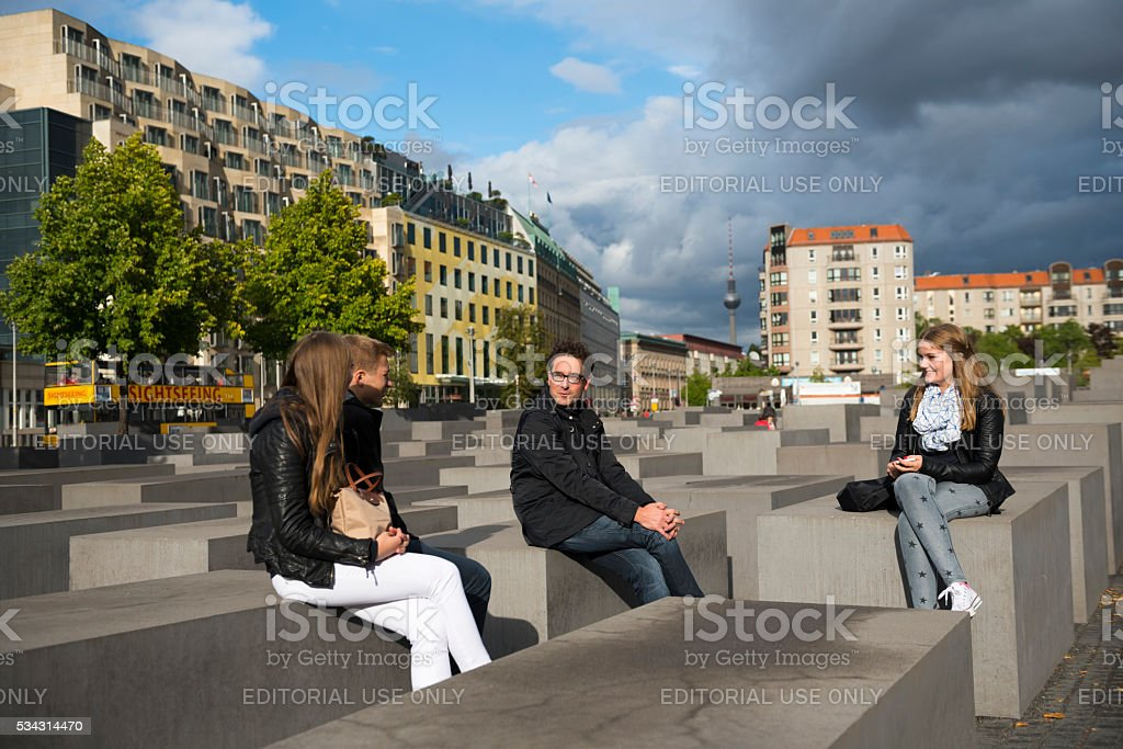 People visiting the Holocaust Memorial in Berlin, Germany stock photo