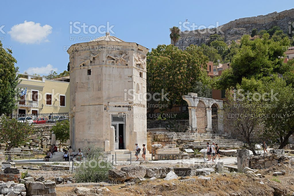 people visiting tower of the winds stock photo