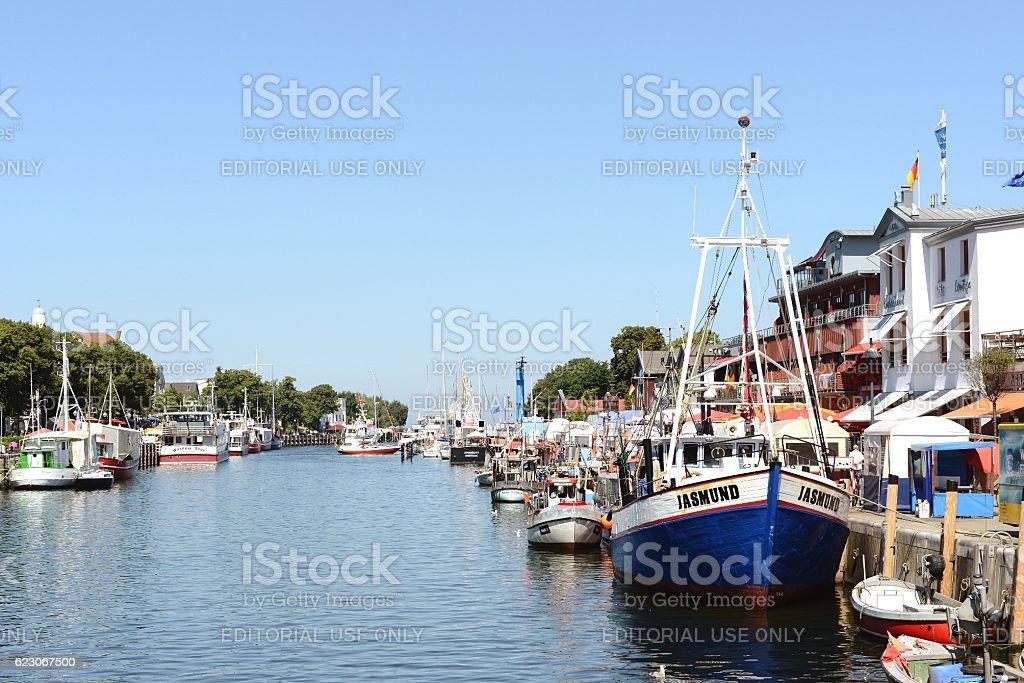 People visiting Warnemuende on Baltic sea (Mecklenburg-Vorpommern, Germany) stock photo