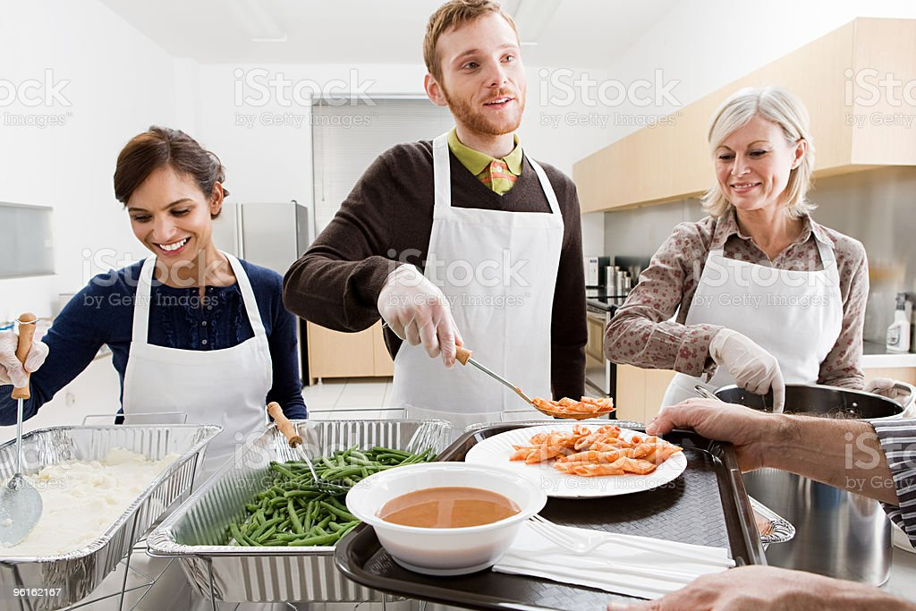 People volunteering at soup kitchen