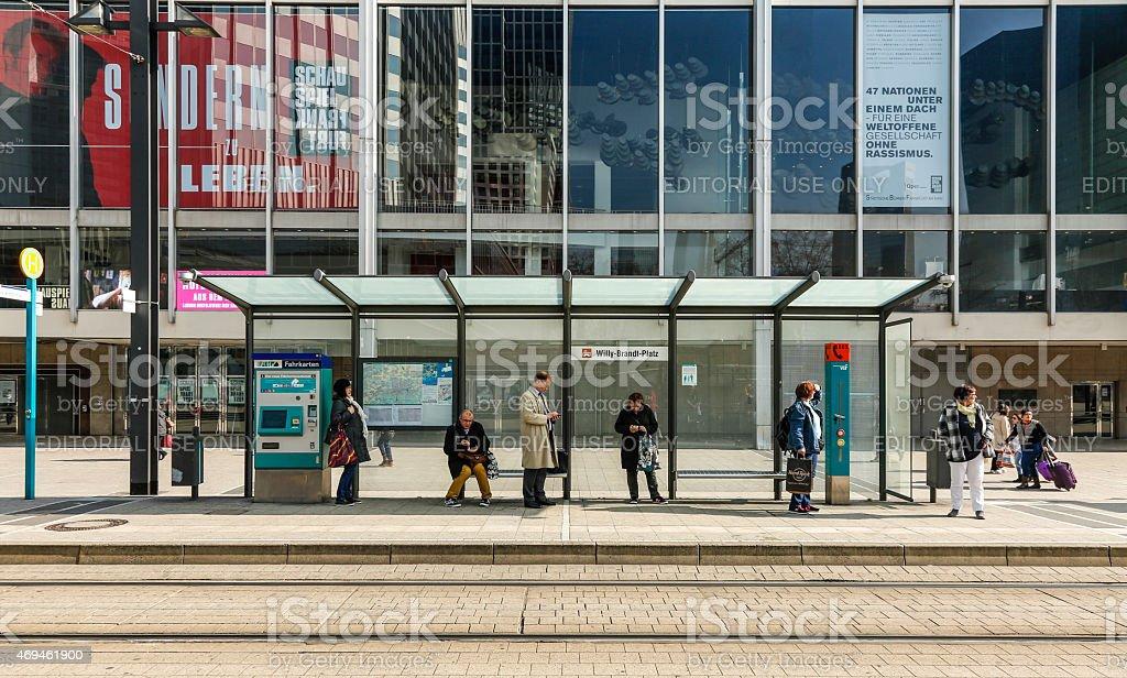 people wait at train station Willi Brandt Platz stock photo