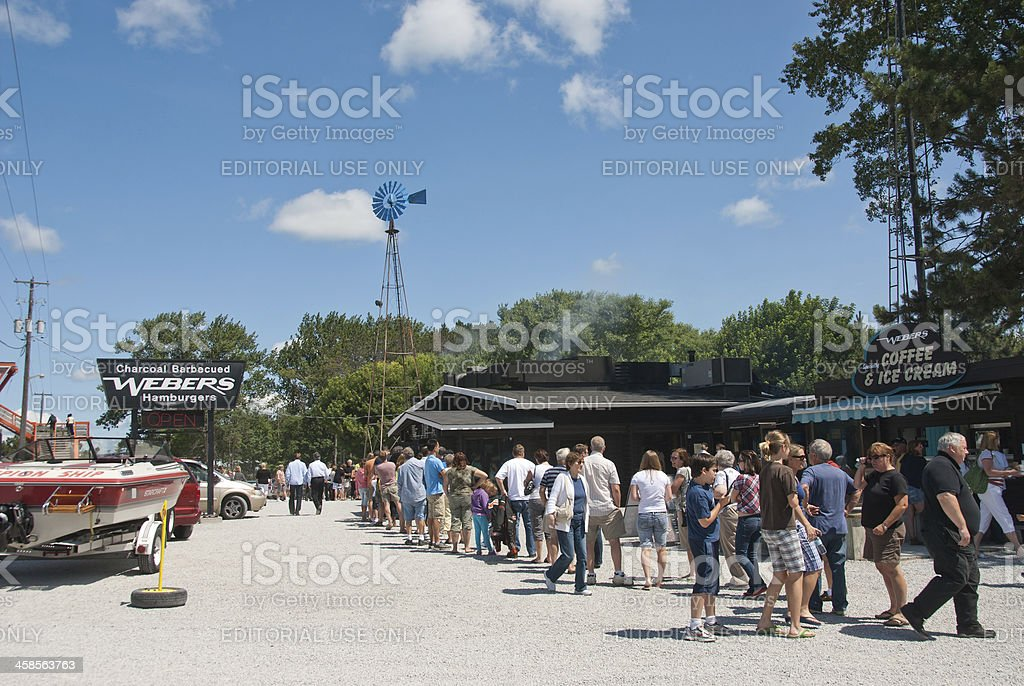 People Wait in Long Line for a Weber's Burger, Canada royalty-free stock photo