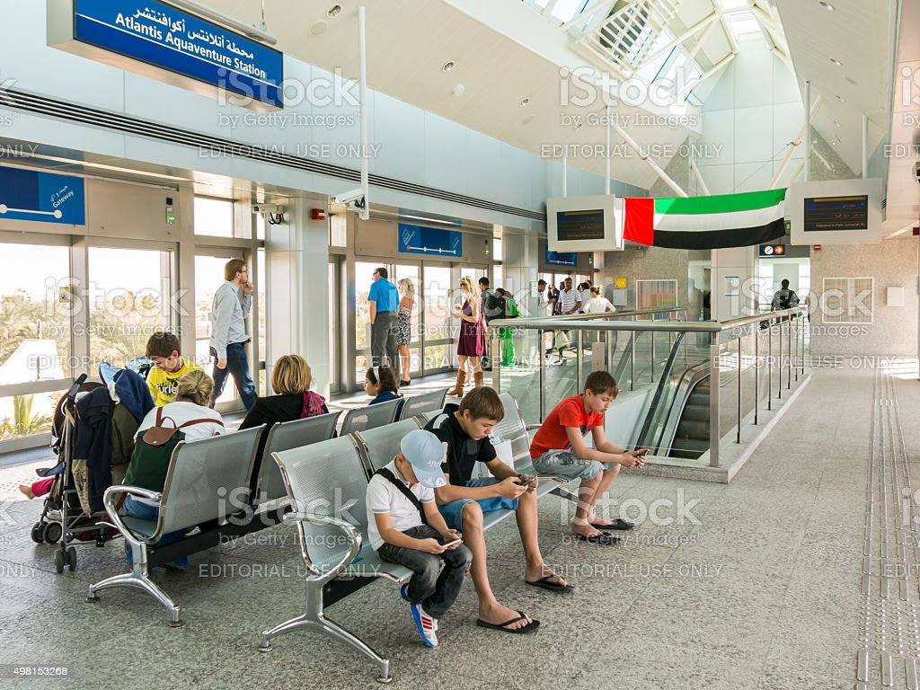 People waiting at Palm Monorail Station in Dubai stock photo