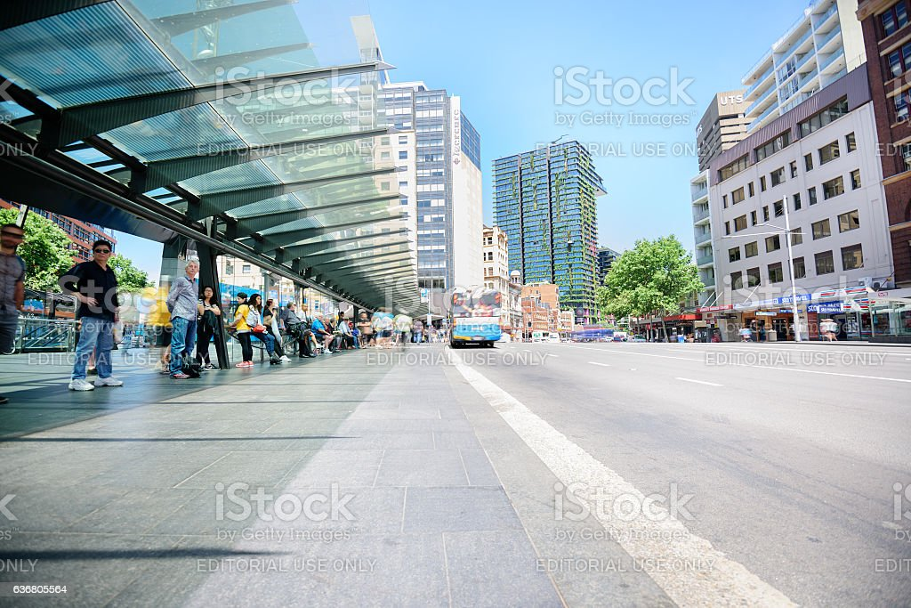 People waiting for bus at bus terminal, motion blurred stock photo