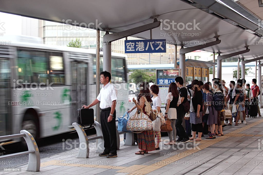People waiting for bus to airport stock photo