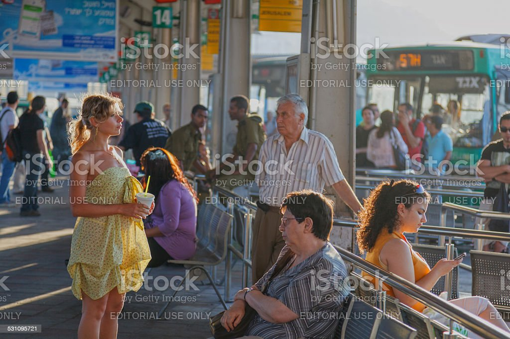 People waiting for buses' departure at intercity station stock photo