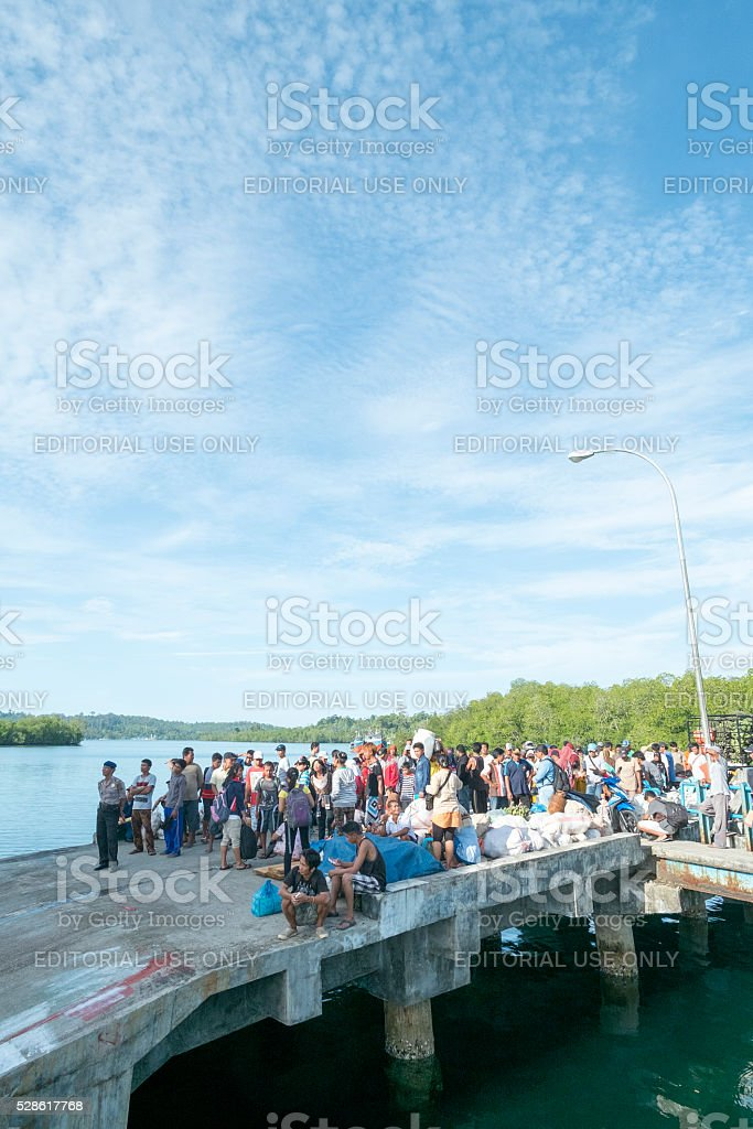 People waiting for ferry at the Port of Muara Siberut. stock photo