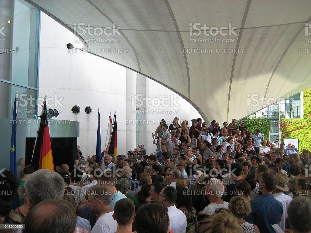 people waiting for Merkel stock photo