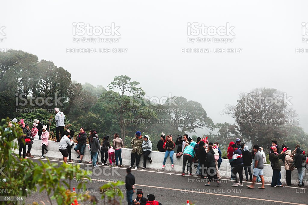 People waiting for sunrise in fog stock photo