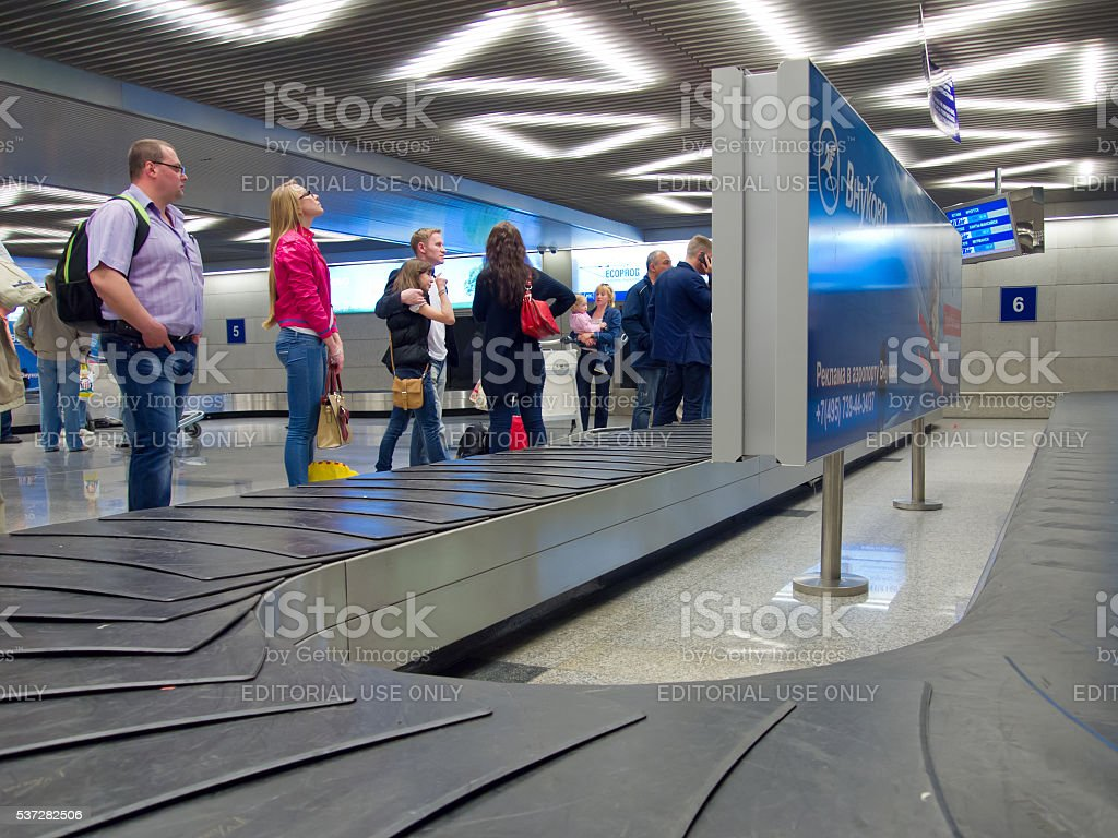 People waiting for the baggage claim at the airport Vnukovo stock photo
