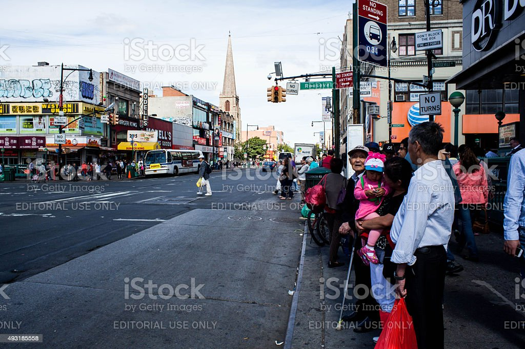 People waiting for the bus in Flushing Queens' Chinatown stock photo