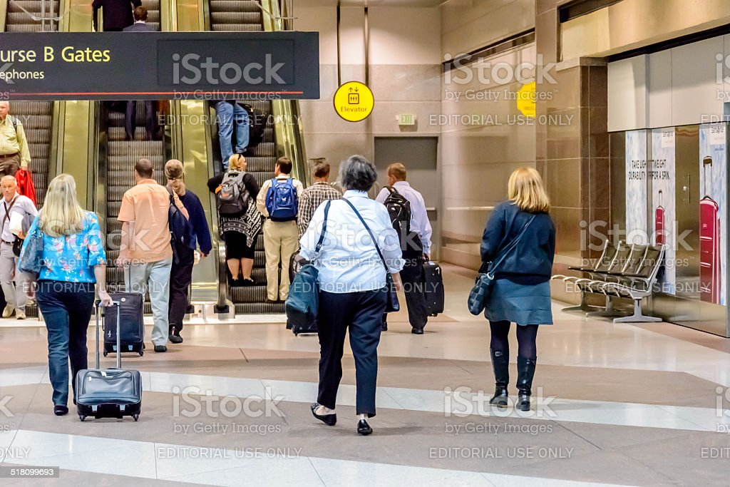 People waiting for the terminal tram at DIA stock photo
