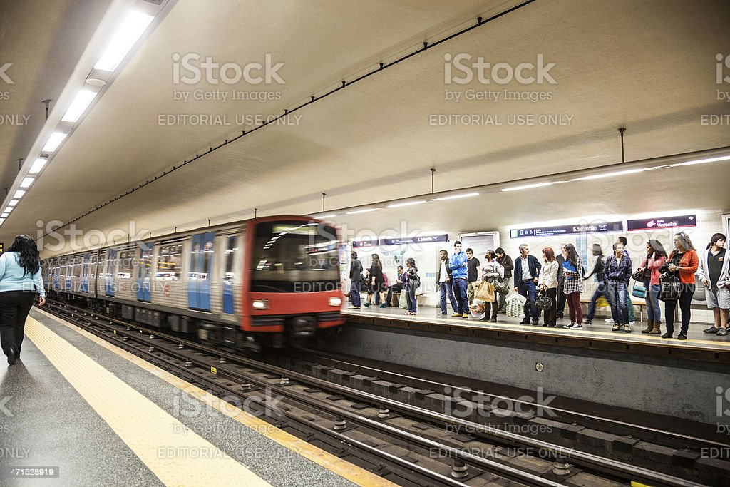 People waiting for the train stop in Lisbon Subway stock photo