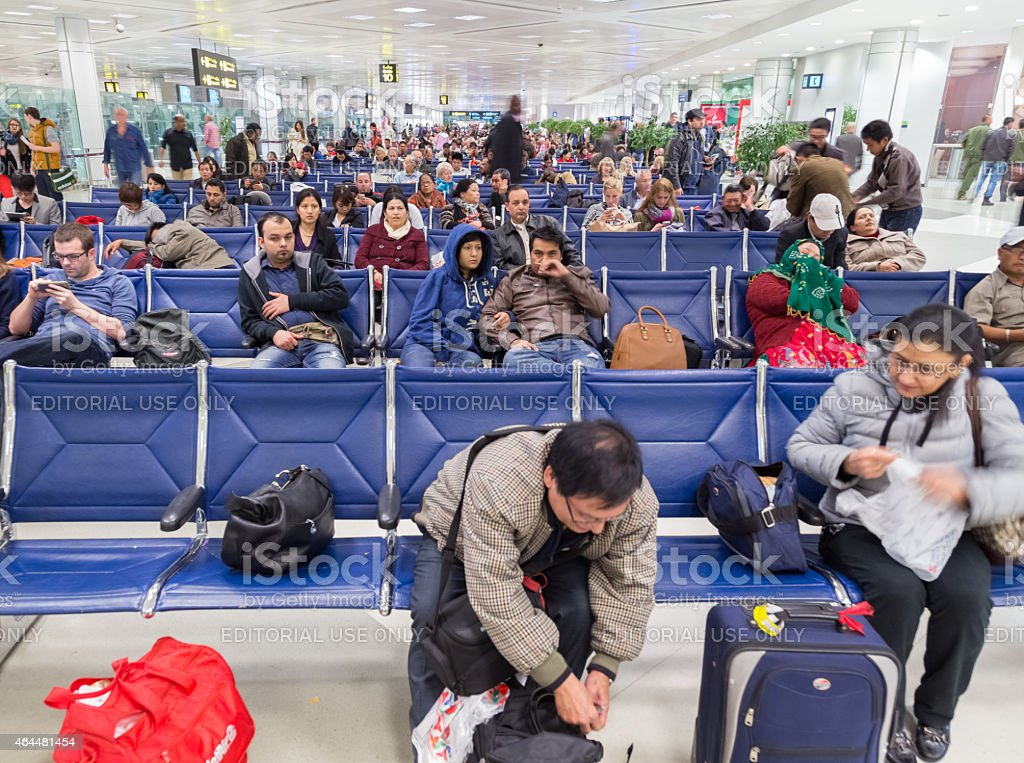 People waiting for their flight at Doha International Airport stock photo