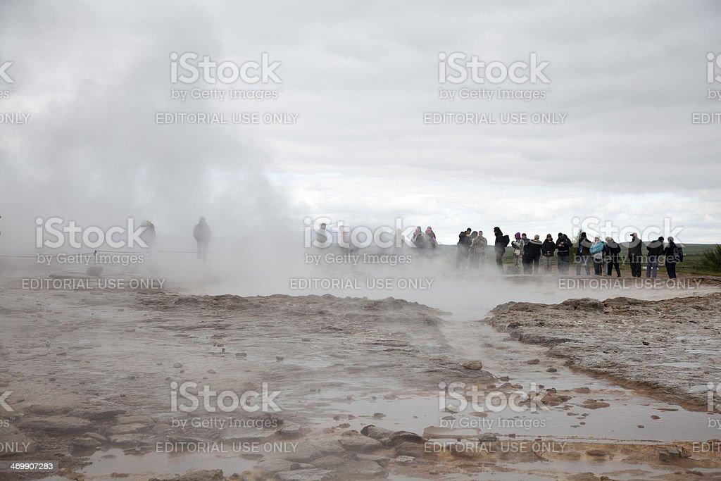 People waiting geyser in Strokkur stock photo