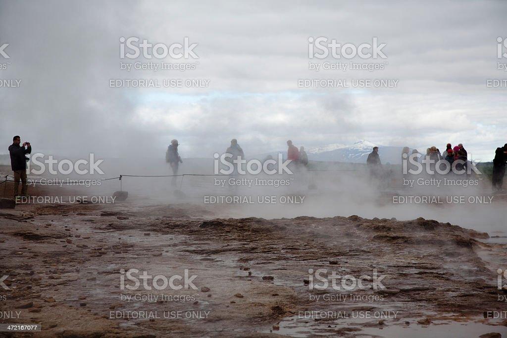 People waiting geyser stock photo