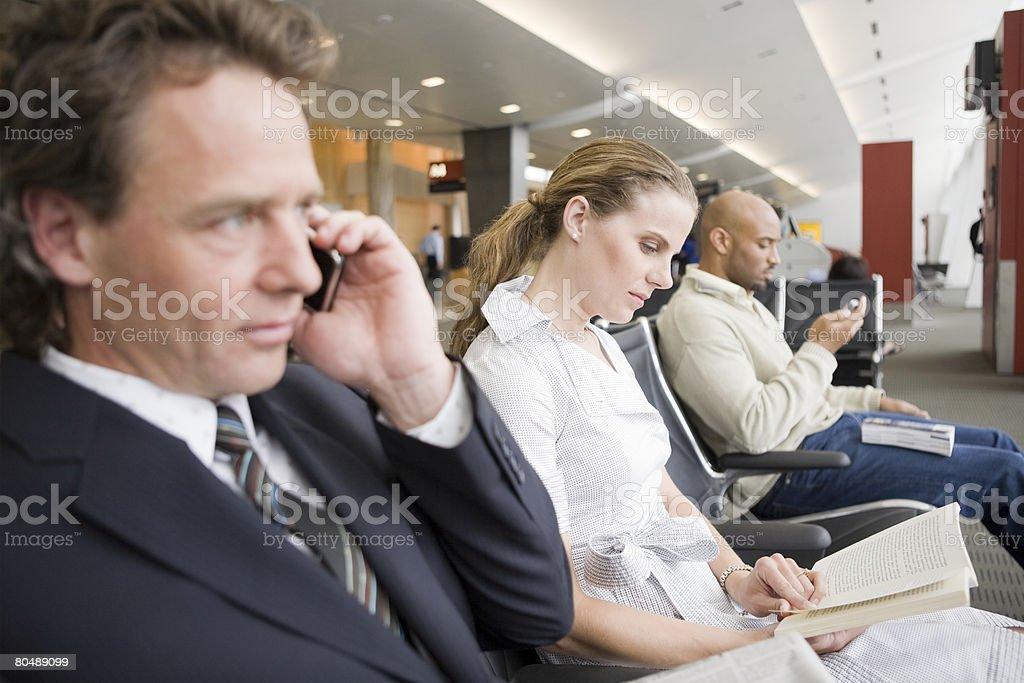 People waiting in a an airport terminal royalty-free stock photo