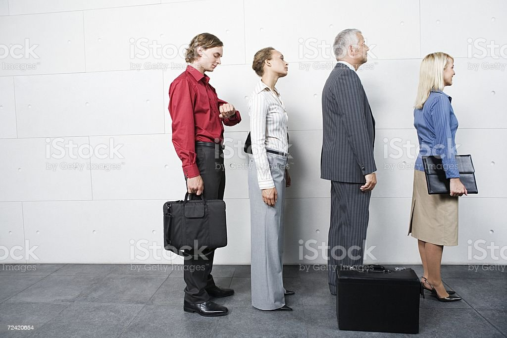 People waiting in a queue royalty-free stock photo