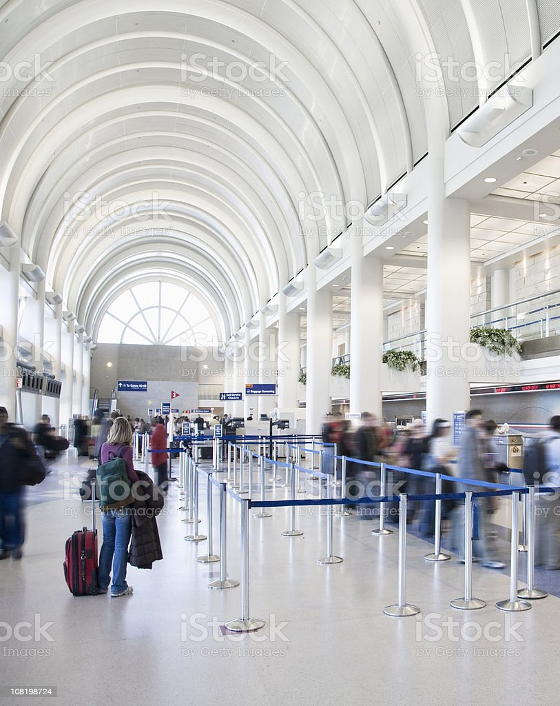People Waiting in Line at Airport Terminal royalty-free stock photo