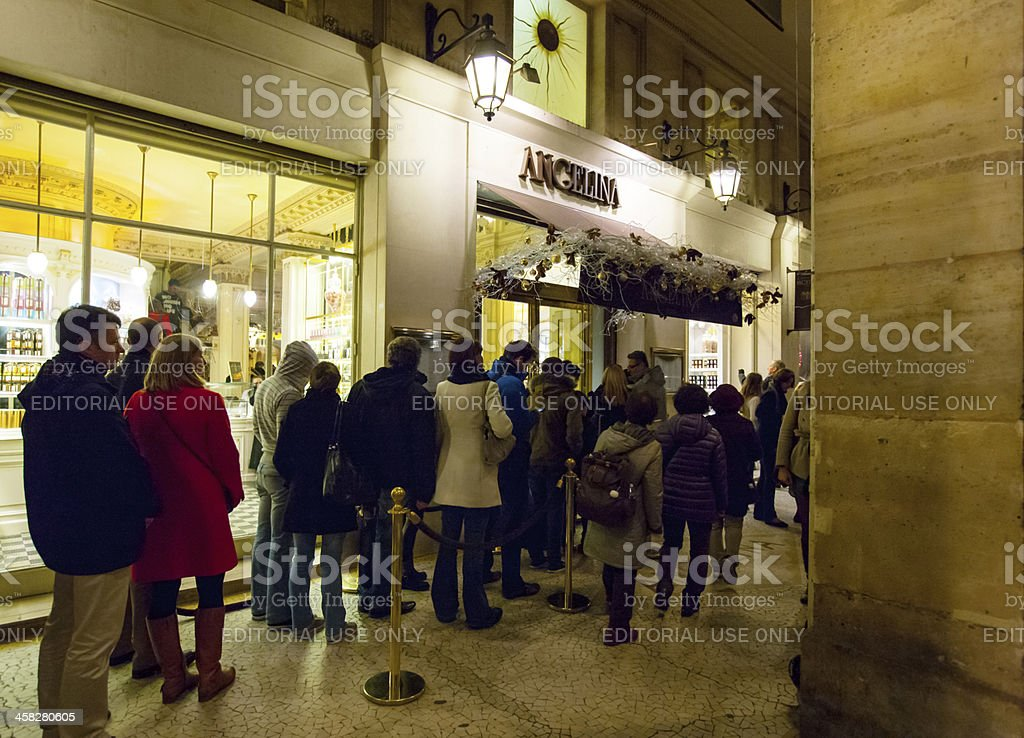 People waiting in line to enter famous Angelina tearoom royalty-free stock photo