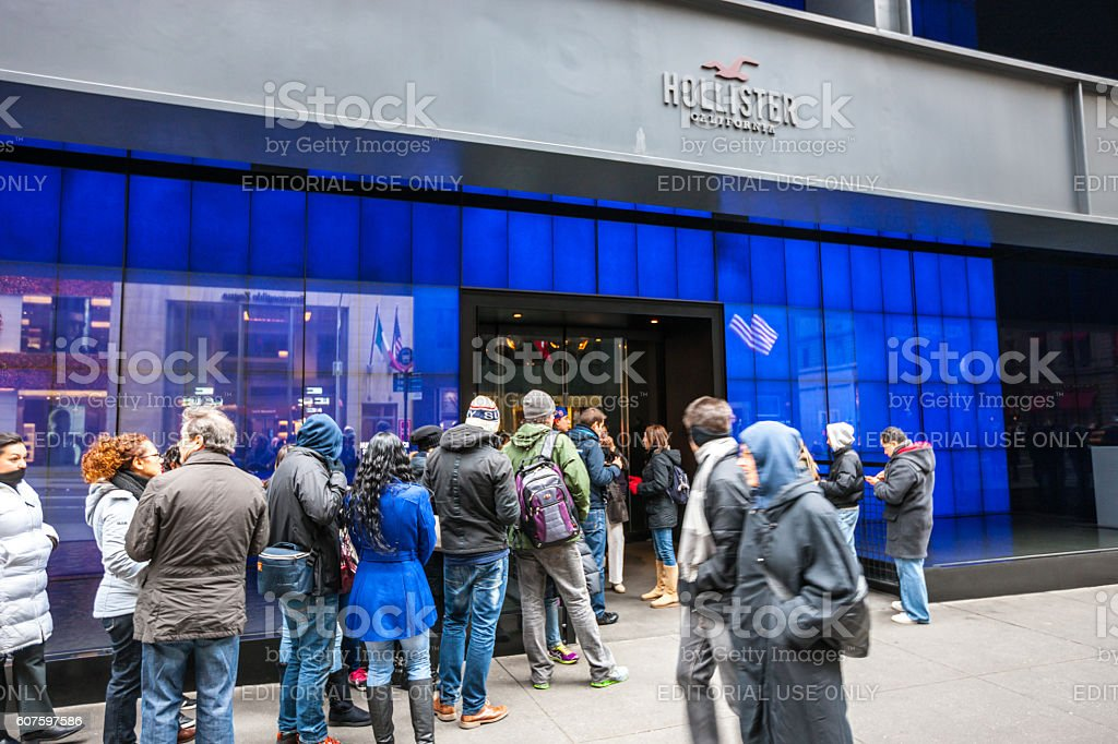 People waiting in line to enter Hollister store, NYC stock photo