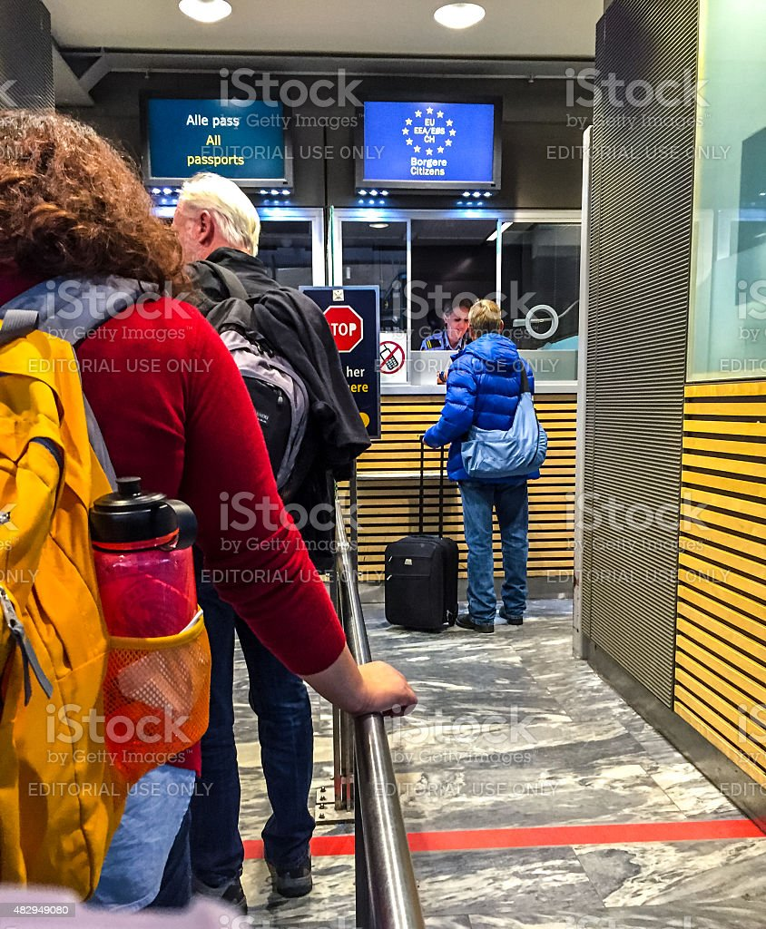 People waiting in line to go through Passport Control, Oslo stock photo