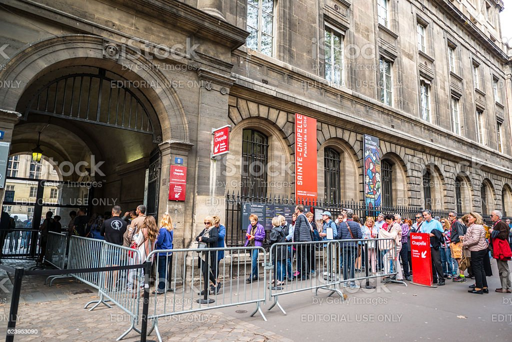 People waiting in line to visit Sainte Chapelle, Paris stock photo