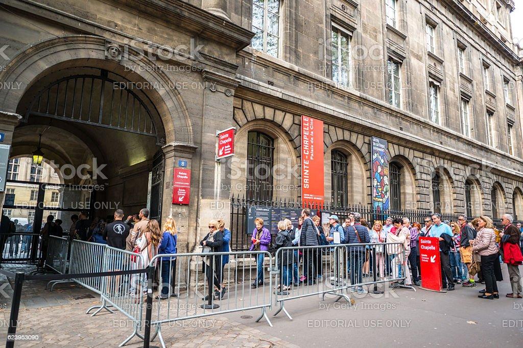 People waiting in line to visit Sainte Chapelle, Paris stock photo