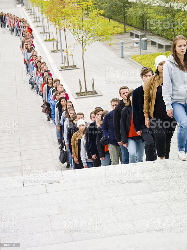 People waiting in long line stock photo