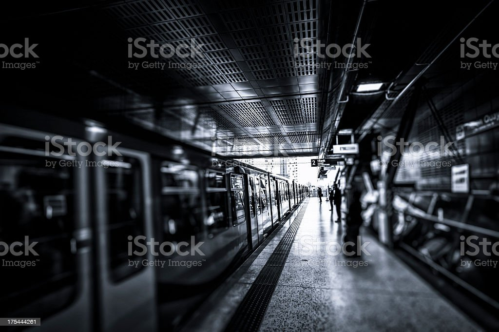 People waiting in subway station at Canary Wharf, London royalty-free stock photo
