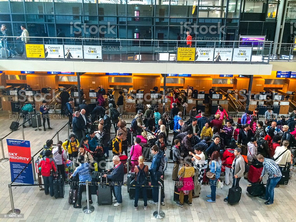 People waiting to make check-in for their flight stock photo