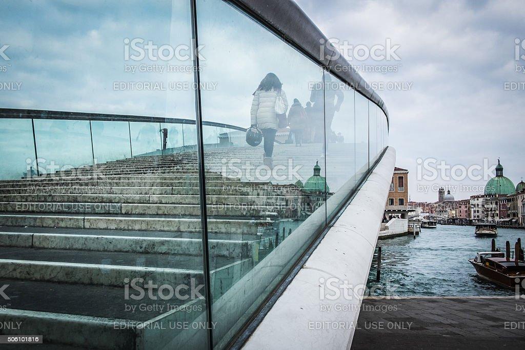 People walk across the glass Constitution Bridge, Venice stock photo