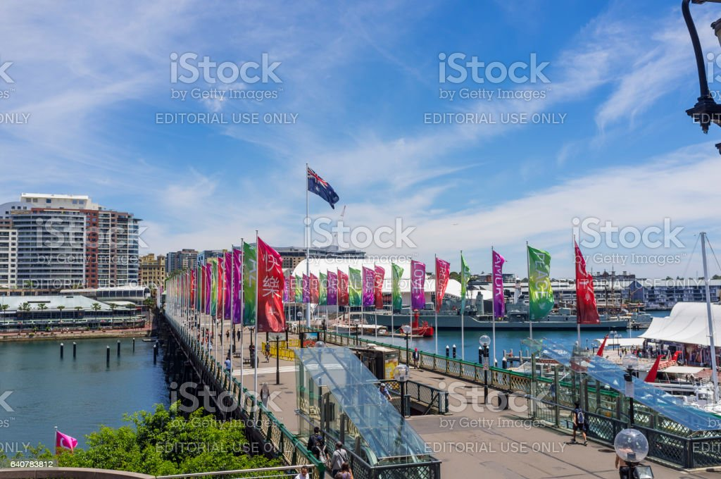 People walk across the Pyrmont Bridge at Darling Harbour in Sydney stock photo