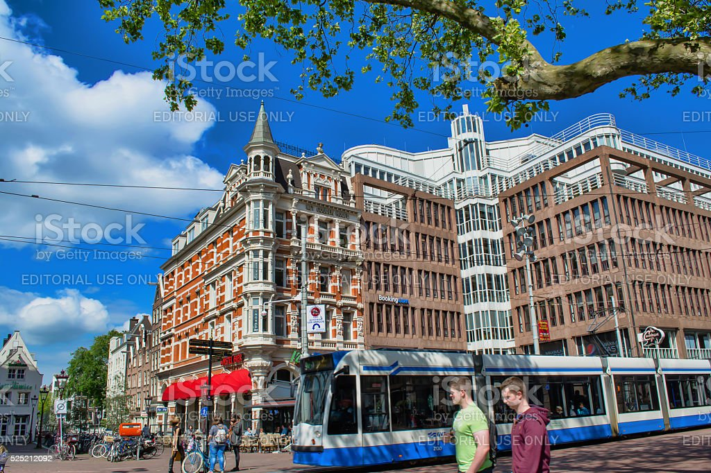 People walk along the path in street in Amsterdam. stock photo