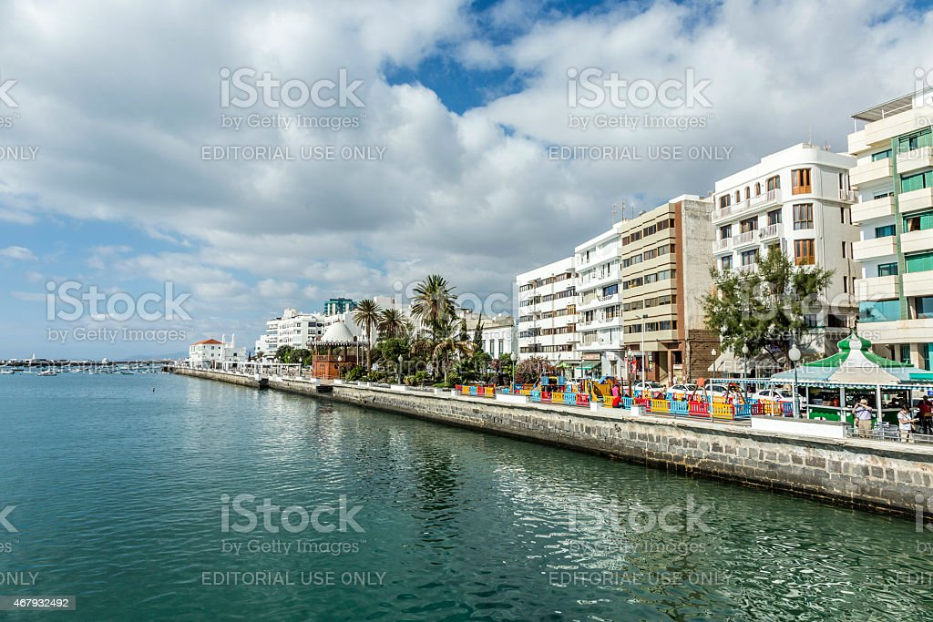 people walk along the promenade in Arrecife stock photo