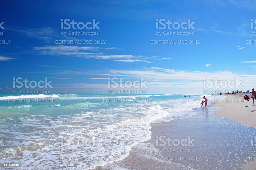 People walk at the sunny South Beach of Miami stock photo