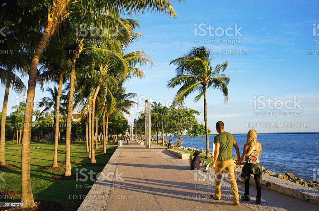 People walk at the sunny South Point Park of Miami stock photo