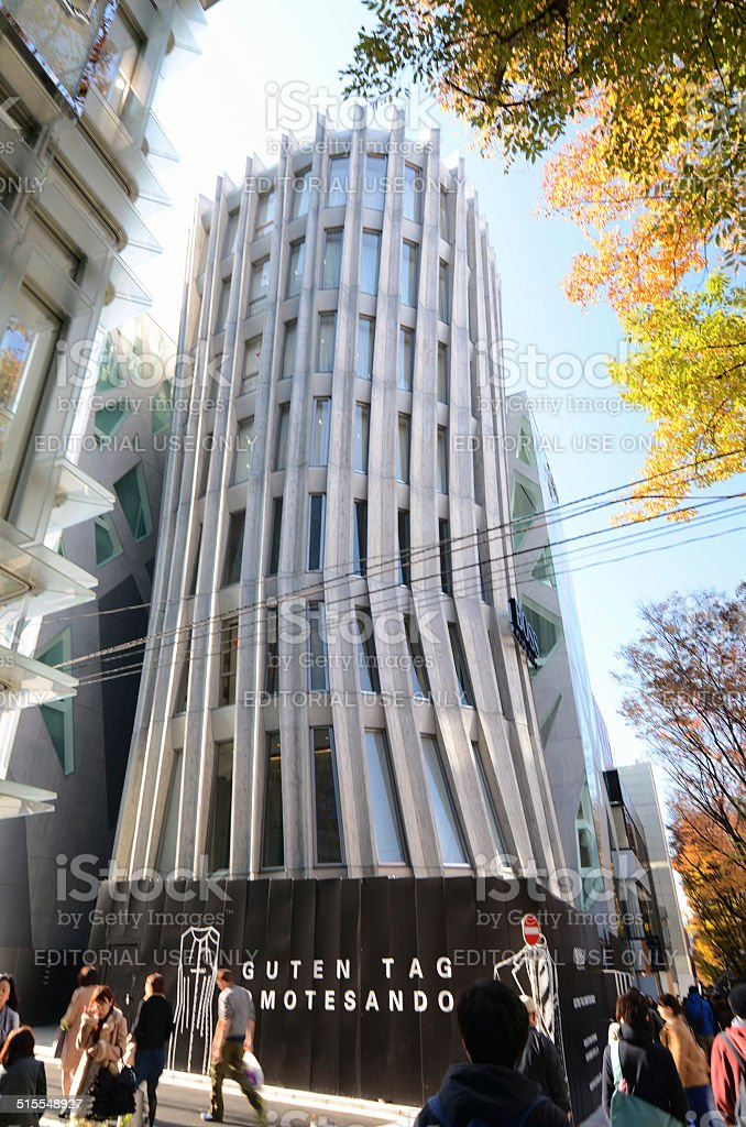 People walk by Futuristic Architecture on Omotesando Street in Tokyo stock photo