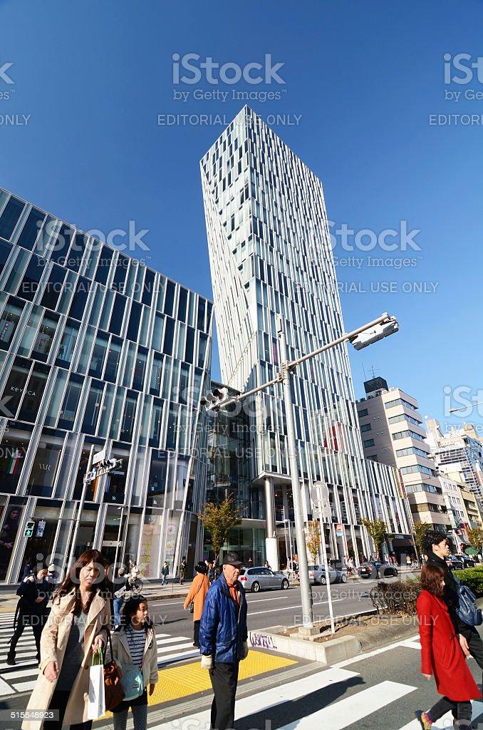 People walk by Futuristic Architecture on Omotesando Street stock photo
