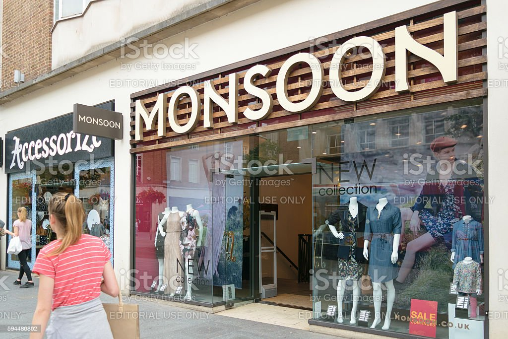 People walk by Monsoon Accesorize shops stock photo