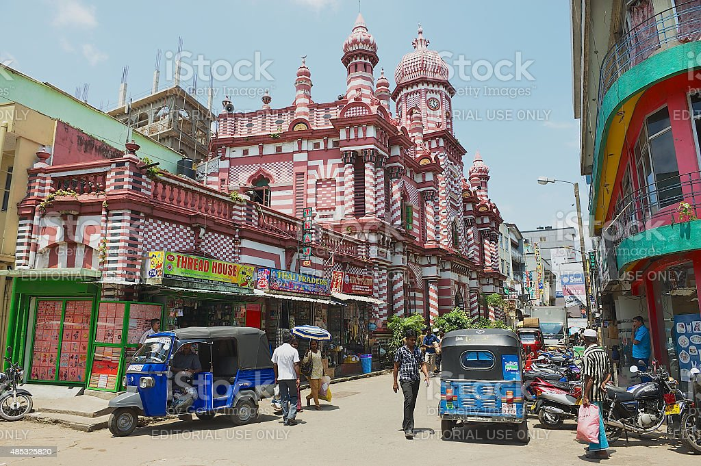 People walk by the street in downtown Colombo, Sri Lanka. stock photo