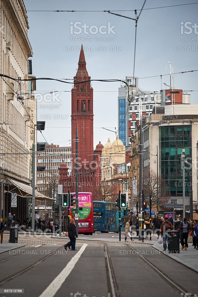 People walk on a central street of Birmingham stock photo