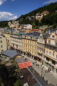 People walk on streets of Czech spa town Karlovy Vary
