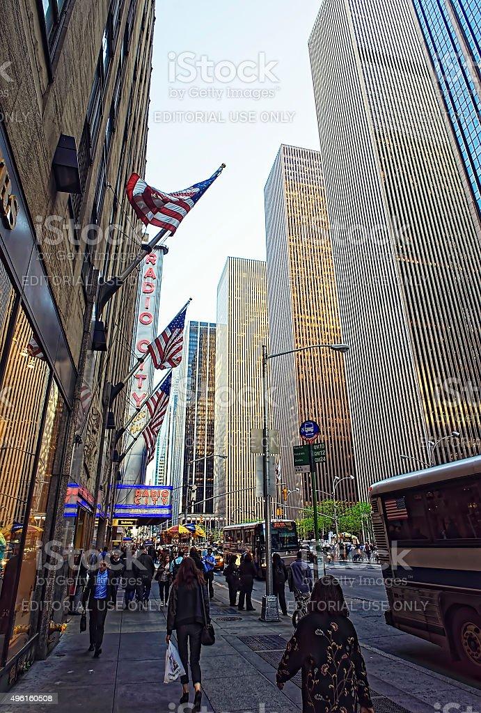 People walk past Radio City Music Hall in NY stock photo