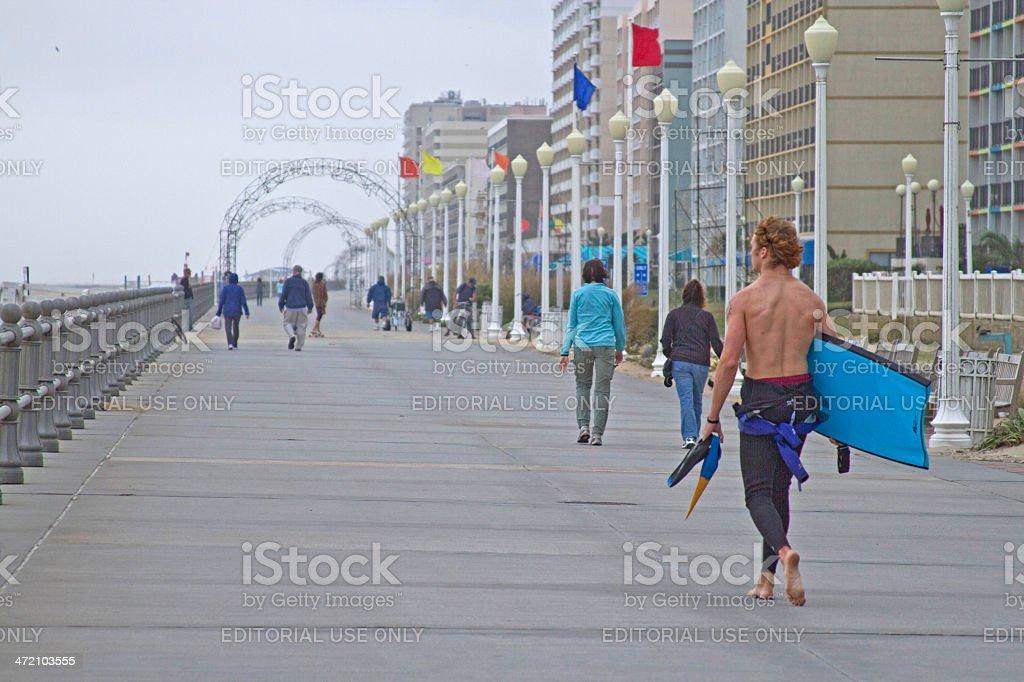 People Walk the Virginia Beach Boardwalk stock photo