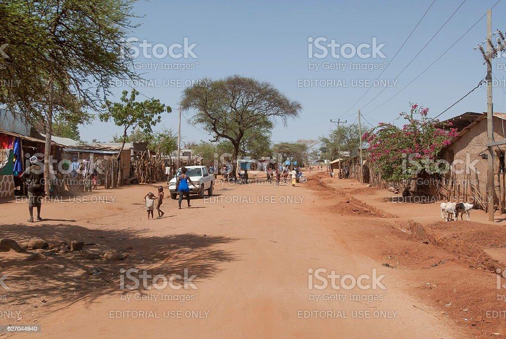 People walk to village market in Dimeka, Valley Omo, Ethiopia. stock photo
