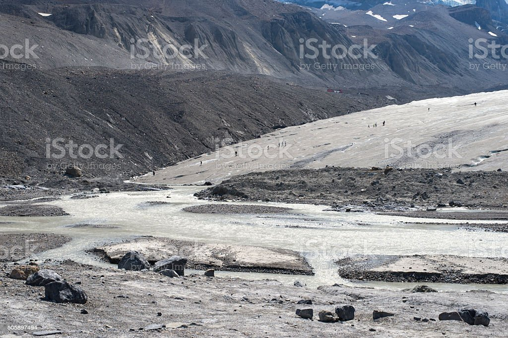 people walking a trail to Athabasca Glacier in Icefield Parkway stock photo
