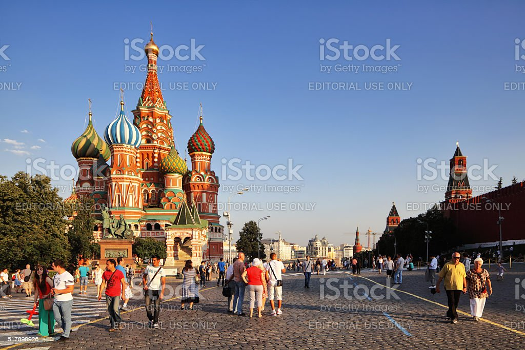 People walking about in Red Square at sunset stock photo
