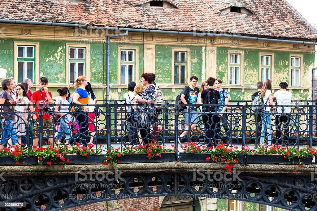 People walking across Liar's Bridge in Sibiu, Transylvania, Romania stock photo