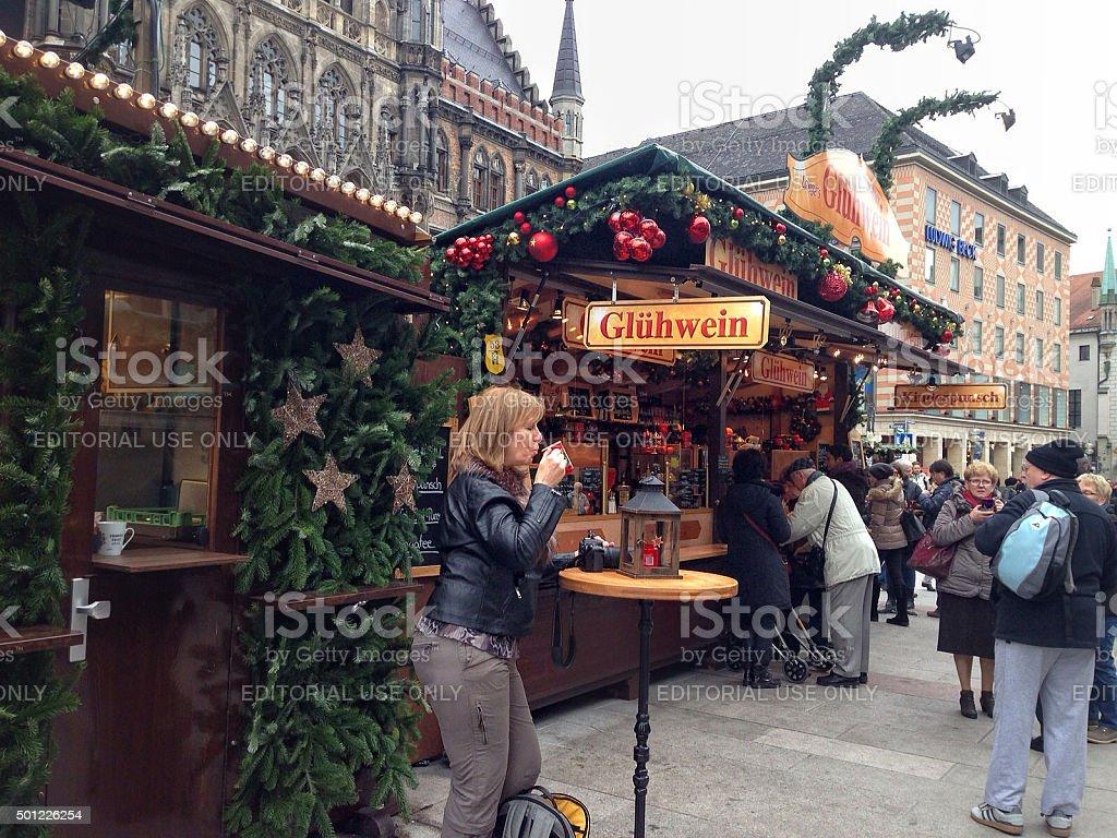 People walking across the Marienplatz of Munich stock photo